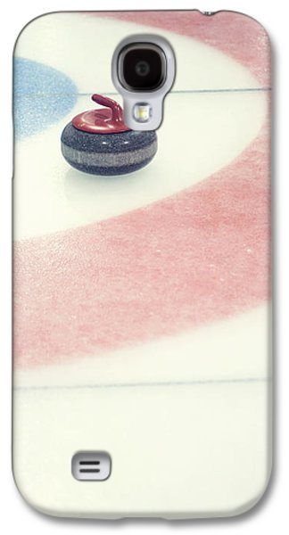 Sports Photographs Galaxy S4 Cases - Curling stone in a distance Galaxy S4 Case by Priska Wettstein
