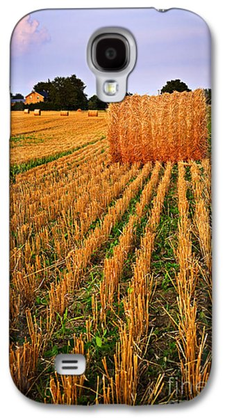 Bale Galaxy S4 Cases - Farm field with hay bales at sunset in Ontario Galaxy S4 Case by Elena Elisseeva