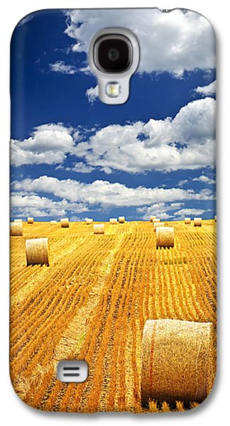 Crops Galaxy S4 Cases - Farm field with hay bales in Saskatchewan Galaxy S4 Case by Elena Elisseeva