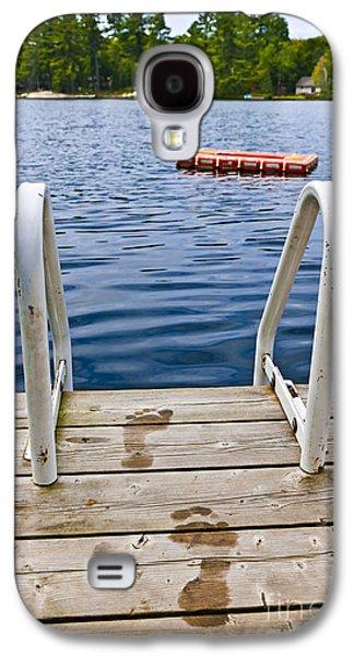 Wooden Platform Galaxy S4 Cases - Footprints on dock at summer lake Galaxy S4 Case by Elena Elisseeva