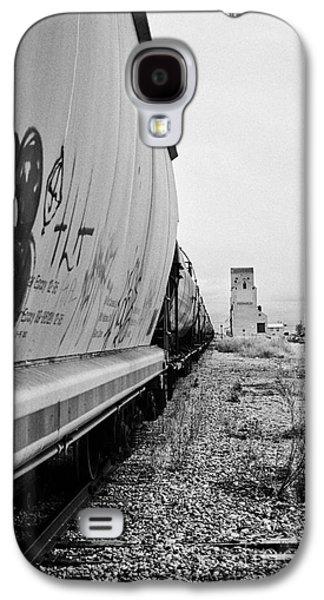 Sask Galaxy S4 Cases - freight grain trucks on canadian pacific railway through assiniboia Saskatchewan Canada Galaxy S4 Case by Joe Fox