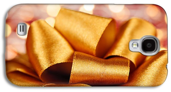 Gift Photographs Galaxy S4 Cases - Gold gift bow with festive lights Galaxy S4 Case by Elena Elisseeva