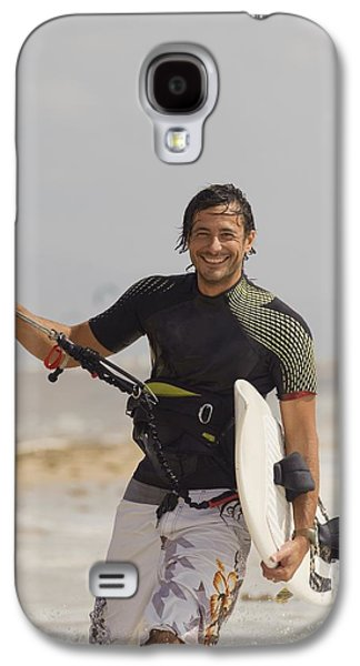 Kiteboarding Galaxy S4 Cases - Man Carrying Kitesurfing Board Galaxy S4 Case by Ben Welsh