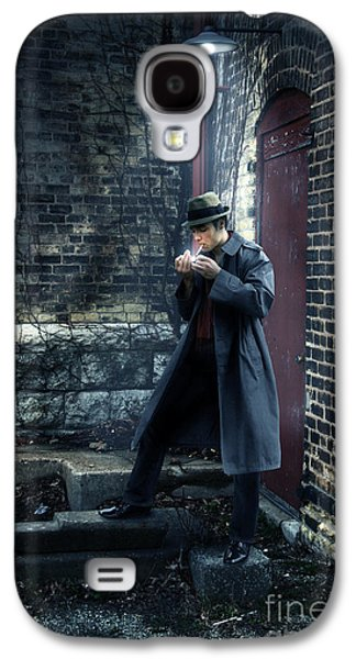 Man Looking Down Galaxy S4 Cases - Man in Trenchcoat Lighting a Cigarette Galaxy S4 Case by Jill Battaglia