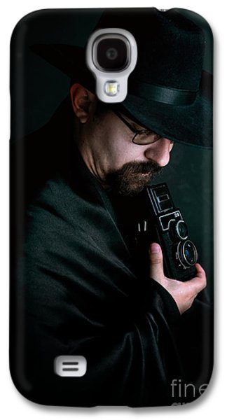 Man With Goatee And Black Hat Holding An Old Style Camera Galaxy S4 Case by Jaroslaw Blaminsky