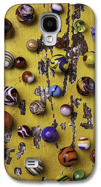 Marble Galaxy S4 Cases - Marbles On Yellow Wooden Table Galaxy S4 Case by Garry Gay