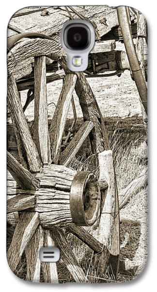 Wooden Wagons Galaxy S4 Cases - Montana Old Wagon Wheels in Sepia Galaxy S4 Case by Jennie Marie Schell