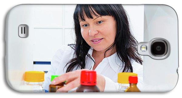 Pharmacist Taking A Bottle From A Shelf Galaxy S4 Case by Wladimir Bulgar