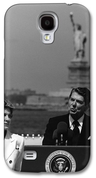Ronald Reagan Galaxy S4 Cases - Reagan Speaking Before The Statue Of Liberty Galaxy S4 Case by War Is Hell Store