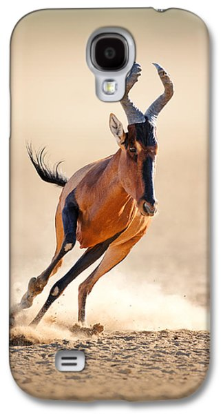 Action Photographs Galaxy S4 Cases - Red hartebeest running Galaxy S4 Case by Johan Swanepoel
