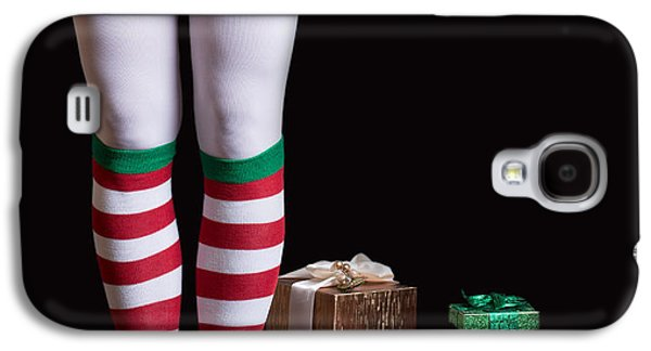 Santas Elf Legs Next To A Pile Of Christmas Gifts Over Black Galaxy S4 Case by Edward Fielding