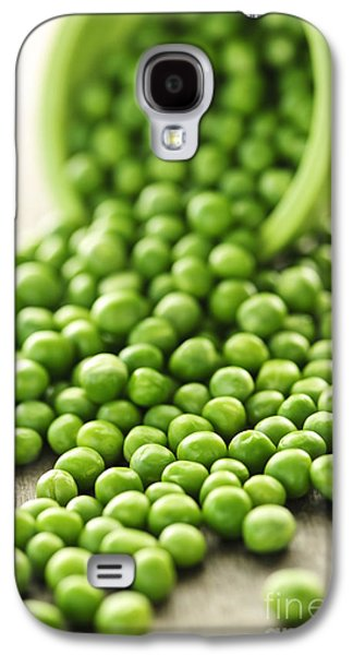 Pour Photographs Galaxy S4 Cases - Spilled bowl of green peas Galaxy S4 Case by Elena Elisseeva