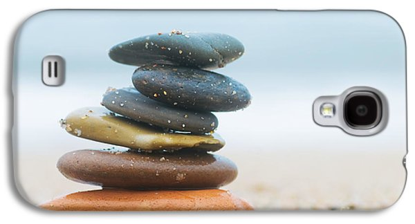 Stone Buildings Galaxy S4 Cases - Stack of beach stones on sand Galaxy S4 Case by Michal Bednarek