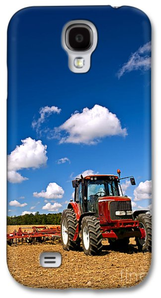 Business Galaxy S4 Cases - Tractor in plowed field Galaxy S4 Case by Elena Elisseeva