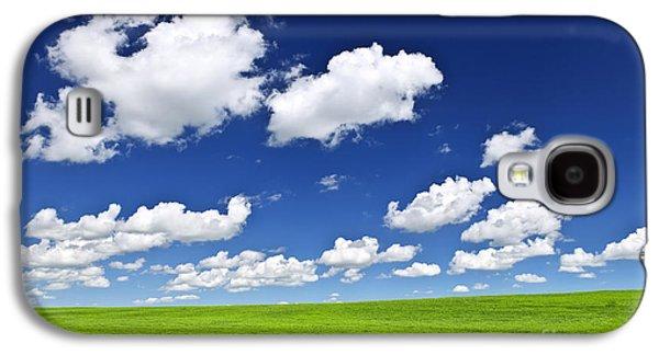 Field. Cloud Galaxy S4 Cases - Green rolling hills under blue sky Galaxy S4 Case by Elena Elisseeva
