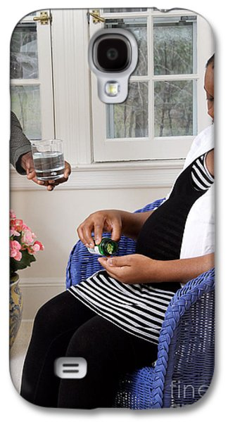 African American Diet Galaxy S4 Cases - Pregnant Woman Taking Vitamins Galaxy S4 Case by Photo Researchers