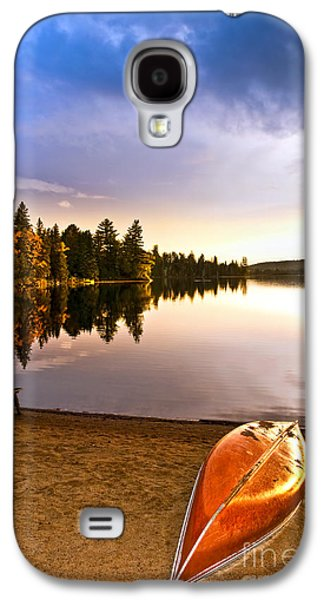 Canoe Galaxy S4 Cases - Lake sunset with canoe on beach Galaxy S4 Case by Elena Elisseeva
