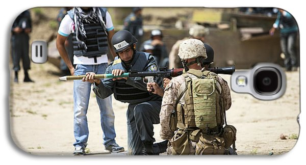 Rpg Galaxy S4 Cases - An Afghan Police Student Loads A Rpg-7 Galaxy S4 Case by Terry Moore