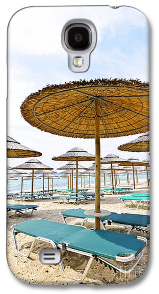 Chair Galaxy S4 Cases - Beach umbrellas and chairs on sandy seashore Galaxy S4 Case by Elena Elisseeva
