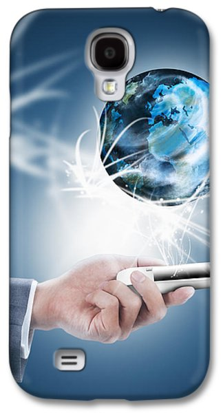 Keyboards Photographs Galaxy S4 Cases - Businessman Holding Mobile Phone With Globe Galaxy S4 Case by Setsiri Silapasuwanchai