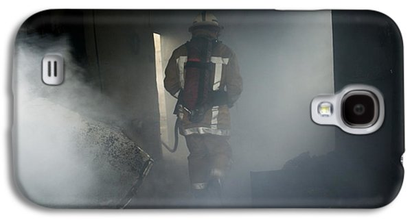 Crime Fighter Galaxy S4 Cases - Fire Fighter In A Burnt House Galaxy S4 Case by Michael Donne