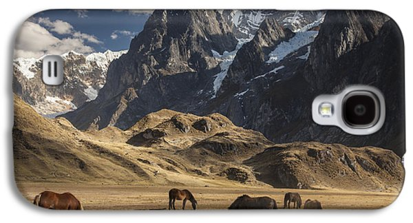Mountain Photographs Galaxy S4 Cases - Horses Grazing Under Siula Grande Galaxy S4 Case by Colin Monteath