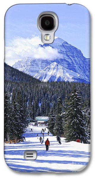 Sports Photographs Galaxy S4 Cases - Skiing in mountains Galaxy S4 Case by Elena Elisseeva