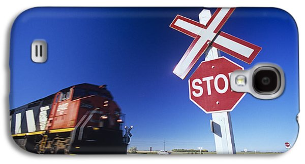 Colour Image Photographs Galaxy S4 Cases - Train Passing Railway Crossing Galaxy S4 Case by Dave Reede