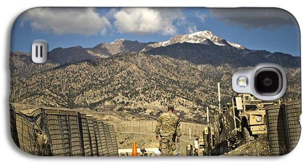 Base Path Galaxy S4 Cases - U.s. Army Soldier Walks Down A Path Galaxy S4 Case by Stocktrek Images