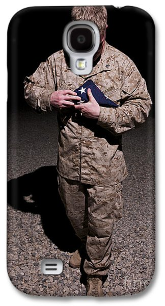 Man Looking Down Galaxy S4 Cases - U.s. Marine Holding The American Flag Galaxy S4 Case by Terry Moore