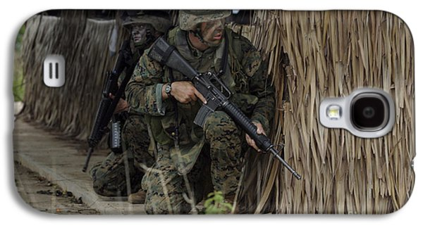 Bamboo House Galaxy S4 Cases - U.s. Marines Prepare To Enter A House Galaxy S4 Case by Stocktrek Images