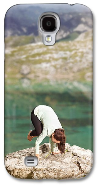 Inner Self Galaxy S4 Cases - Woman doing yoga on a rock on the lake shore Galaxy S4 Case by Wolfgang Steiner