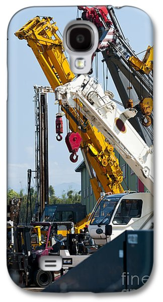 Machinery Galaxy S4 Cases - A Group Of Mobile Cranes. Hooks Galaxy S4 Case by Lawren Lu