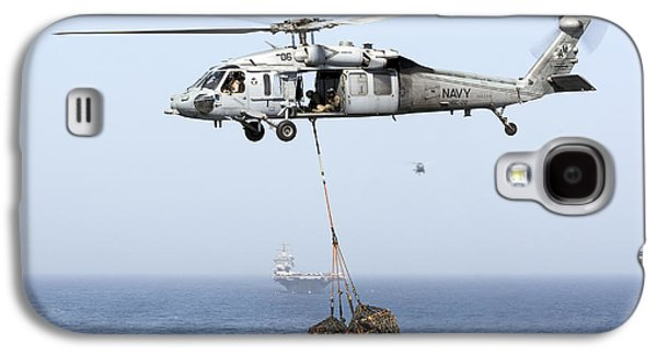 Enterprise Galaxy S4 Cases - A Mh-60 Helicopter Transfers Cargo Galaxy S4 Case by Gert Kromhout