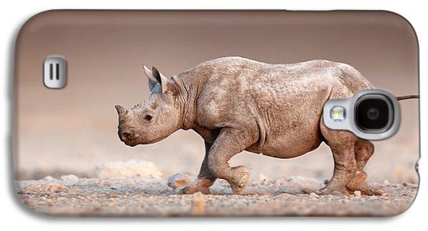 Open Photographs Galaxy S4 Cases - Black Rhinoceros baby running Galaxy S4 Case by Johan Swanepoel