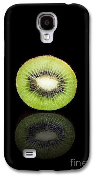 Studio Photographs Galaxy S4 Cases - Half kiwi on a black reflective background Galaxy S4 Case by Sara Winter
