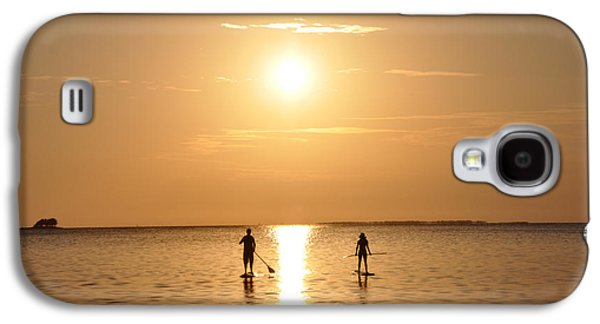 Paddle Galaxy S4 Cases - Paddle Boarding Out of the Sunset Galaxy S4 Case by Bill Cannon