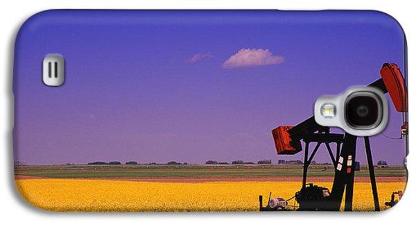 Machinery Galaxy S4 Cases - Pumpjack In A Canola Field Galaxy S4 Case by Carson Ganci