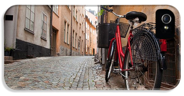 Wall iPhone 5 Cases - A bike in the old town of stockholm iPhone 5 Case by Michal Bednarek