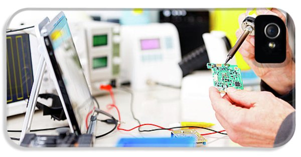 Person Repairing Electronic Circuit Board IPhone 5 / 5s Case by Wladimir Bulgar