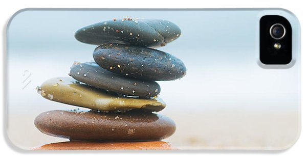 Stone iPhone 5 Cases - Stack of beach stones on sand iPhone 5 Case by Michal Bednarek