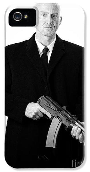 British Crime iPhone 5 Cases - Bald Headed Man Wearing Heavy Black Overcoat Holding Ak-47 iPhone 5 Case by Joe Fox
