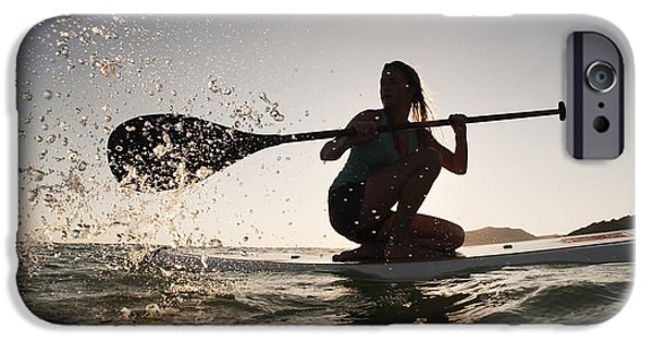 25-29 Years iPhone Cases - A Woman Paddling While On Her Knees On iPhone Case by Ben Welsh
