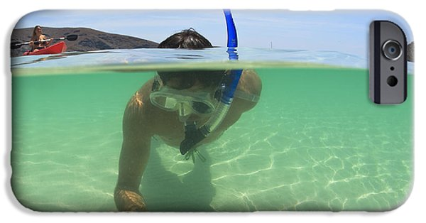 35-39 Years iPhone Cases - A Young Man Snorkels Holding A Starfish iPhone Case by Stuart Westmorland
