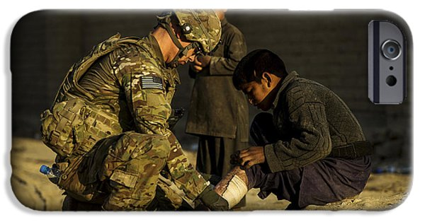 East Village iPhone Cases - Airman Provides Medical Aid To A Local iPhone Case by Stocktrek Images