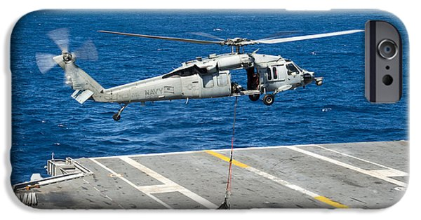 At Arrivals iPhone Cases - An Mh-60s Sea Hawk Delivers Supplies iPhone Case by Stocktrek Images