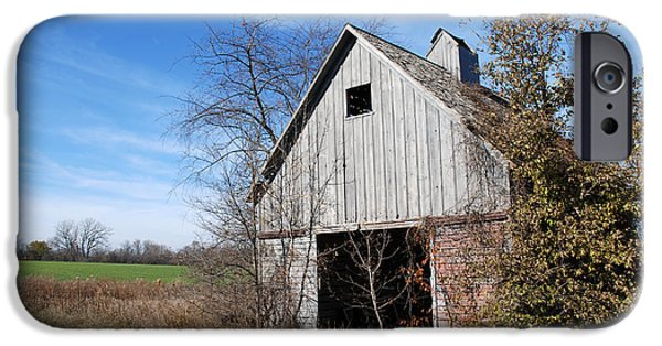Illinois Barns iPhone Cases - An old rundown abandoned wooden barn under a blue sky in midwestern Illinois USA iPhone Case by Paul Velgos
