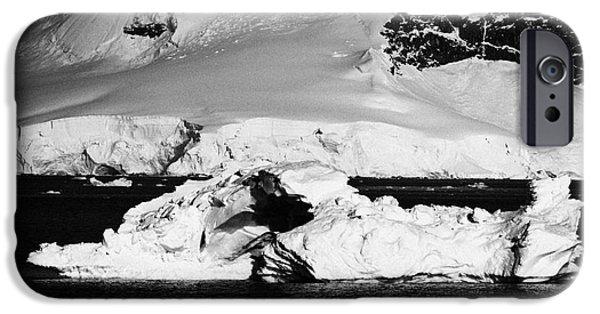 Snow Scene iPhone Cases - arched iceberg in wilhelmina bay Antarctica iPhone Case by Joe Fox