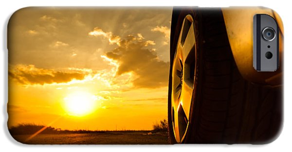 Asphalt Pyrography iPhone Cases - Close up shot of a car against sunset in the background iPhone Case by Oliver Sved