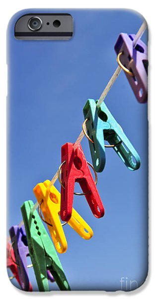 Diversity iPhone Cases - Colorful clothes pins iPhone Case by Elena Elisseeva